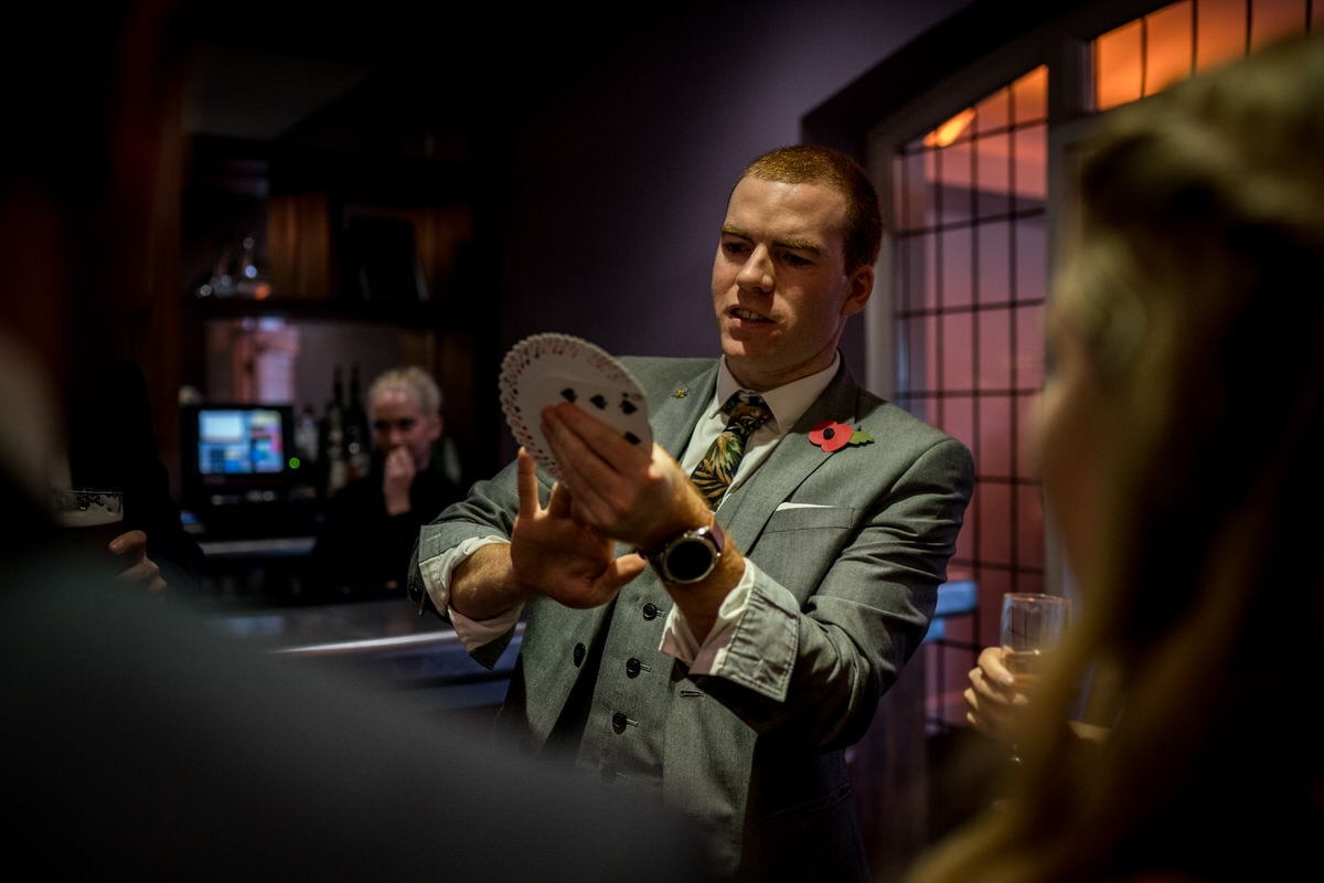 magician sam fitton and playing cards at colshaw hall