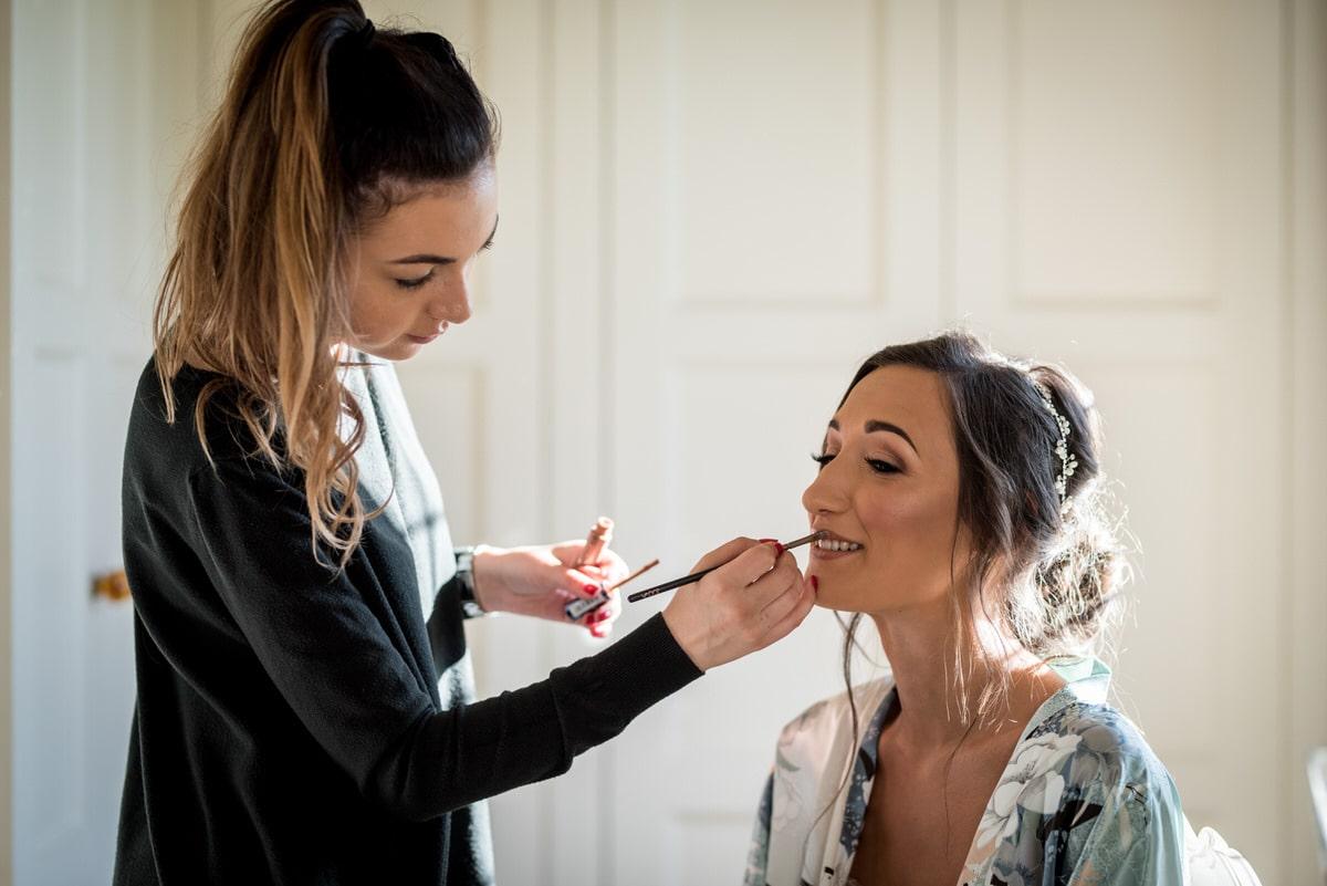 bride having lipstick applied at colshaw hall