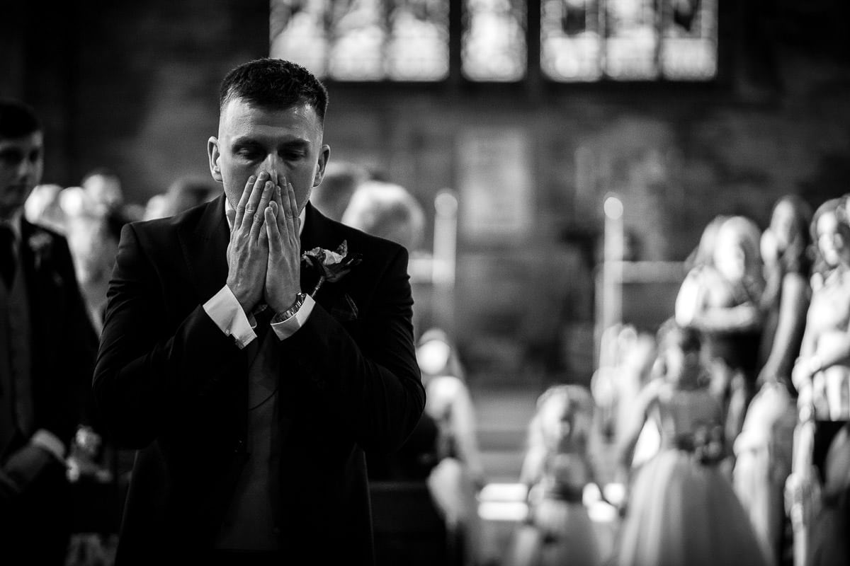 groom getting emotional as he sees his daughter