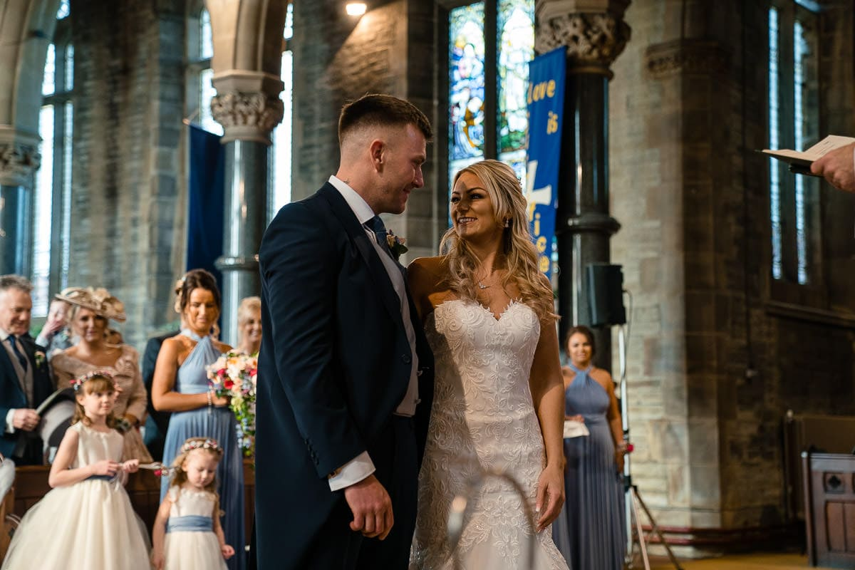 bride and groom at christ church walshaw