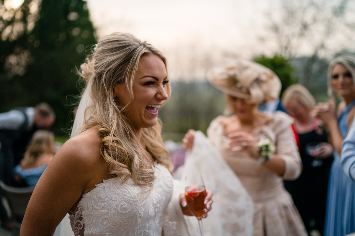 bride laughing at drinks reception