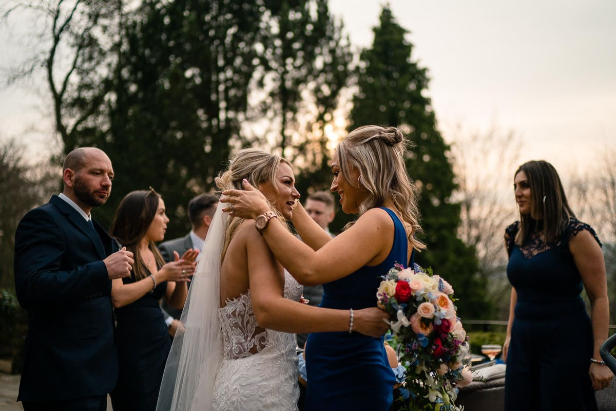 bride being hugged at mitton hall wedding