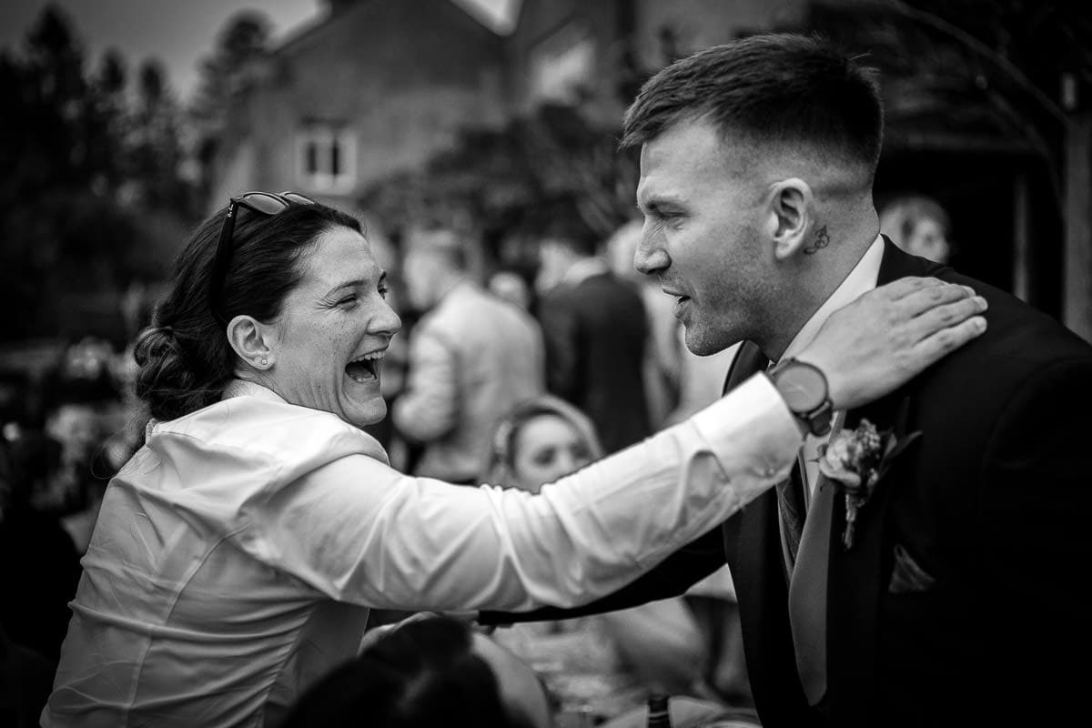 groom being hugged at mitton hall wedding