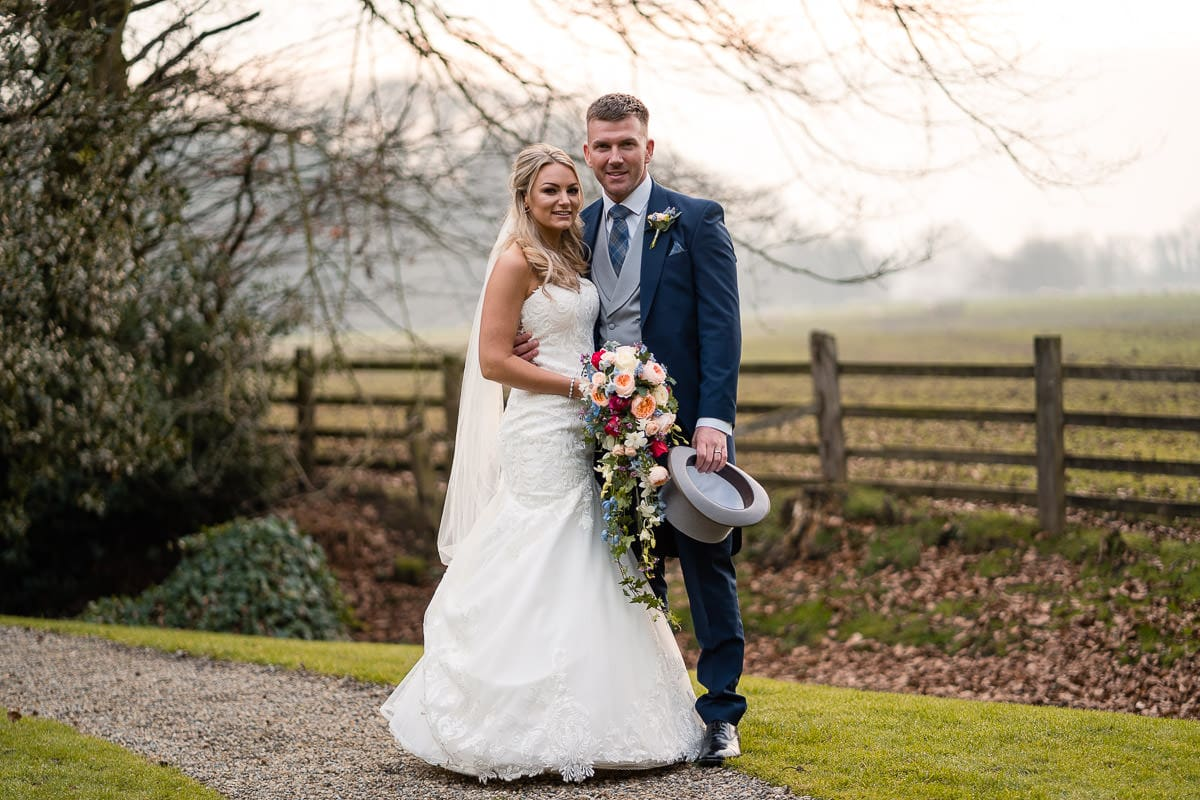 posed photo of couple at mitton hall wedding