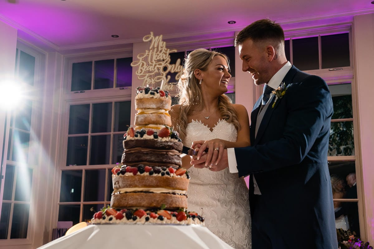 cake cutting at mitton hall wedding