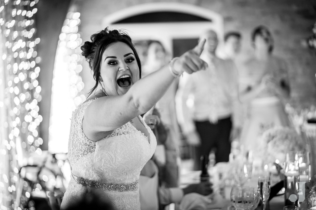 bride pointing at funny speech