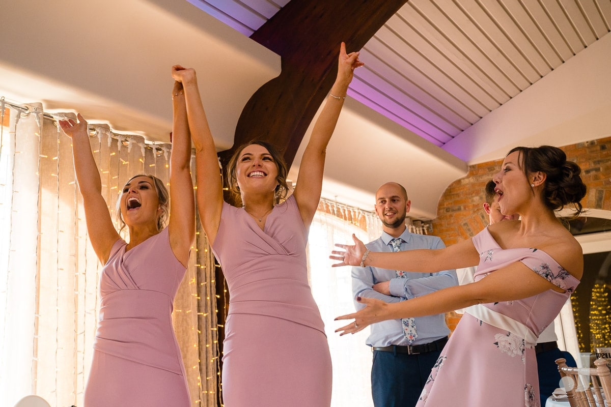 happy bridesmaids cheering