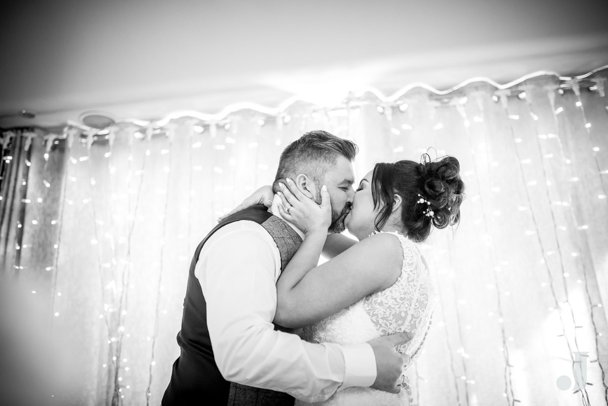 bride kissing her husband after the speech