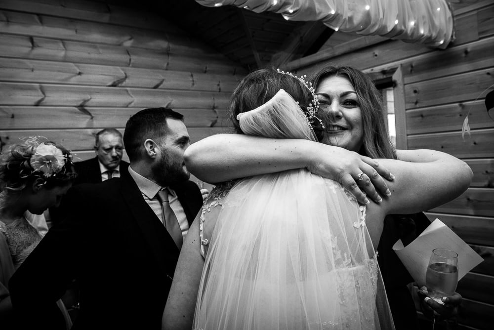 hugs at wedding reception