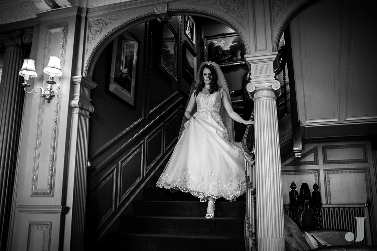 bride on stairs at Thornton Manor wedding