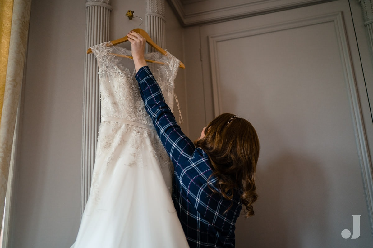 bride hanging up her dress at Thornton Manor