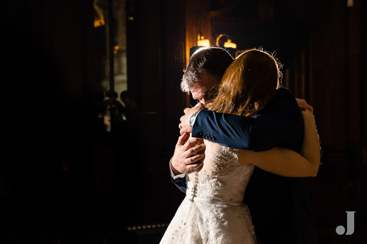 bride and groom hugging at Thornton Manor