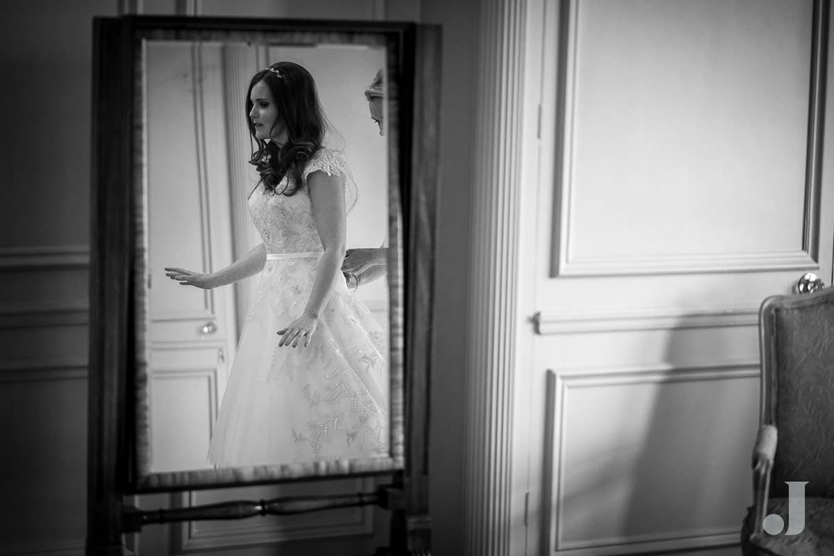 bride reflected in mirror at Thornton Manor