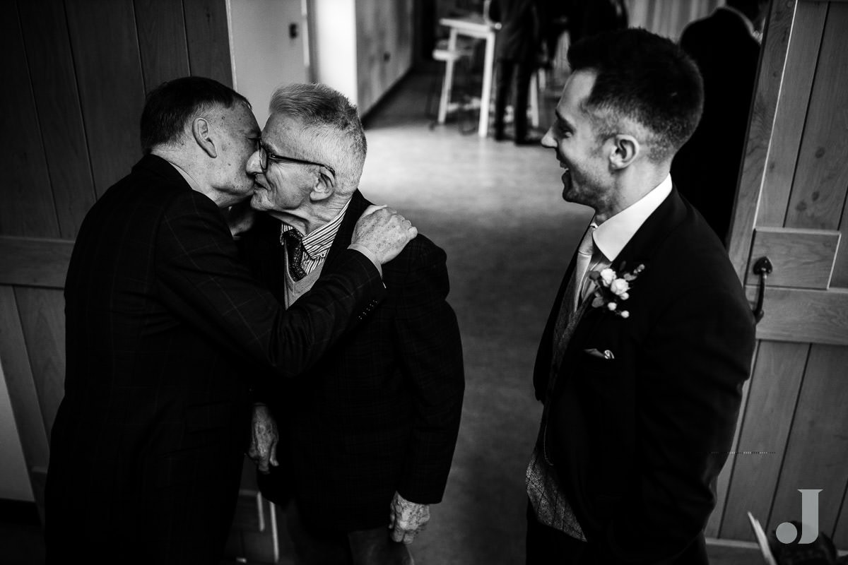 hugs before the wedding at the holford estate