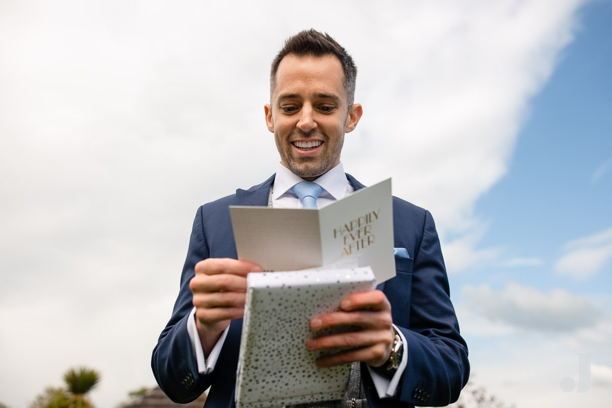 groom reading wedding card