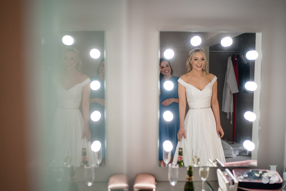 bride in mirror at the holford estate